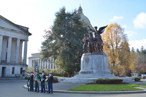 Soldiers standing in front of the Winged Victory monument